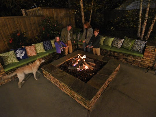 A Shreveport family enjoys a warm fire on a cold night