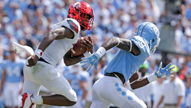 Louisville quarterback Lamar Jackson runs for a touchdown as North Carolina's K.J. Sails (9) chases during the second half of an NCAA college football game in Chapel Hill, N.C., Saturday, Sept. 9, 2017. Louisville won 47-35.