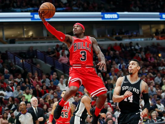 Chicago Bulls guard Kay Felder (3) goes to the basket in front of San Antonio Spurs guard Danny Green (14) during the first half of an NBA basketball game, Saturday, Oct. 21, 2017, in Chicago. (AP Photo/Kamil Krzaczynski)
