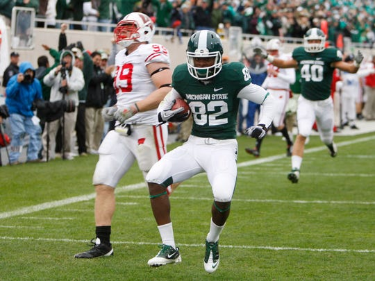 Michigan State wide receiver Keshawn Martin (82) outruns Wisconsin defensive tackle J.J. Watt (99) for a touchdown on Oct. 2, 2010.