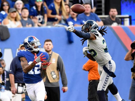 Seattle Seahawks cornerback Richard Sherman (25) tips a pass intended for New York Giants wide receiver Tavarres King (12) in the first half. The New York Giants lead the Seattle Seahawks 7-3 at the half on Sunday, October 22, 2017 in East Rutherford, NJ.
