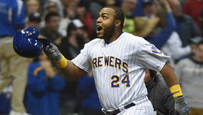 Brewers slugger Jesus Aguilar gets ready to toss his helmet aside as he nears the plate after hitting a walkoff homer leading off the bottom of the ninth inning against the Marlins on Saturday night.