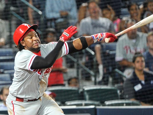 Philadelphia Phillies' Maikel Franco strikes out swinging to end a baseball game, against the Atlanta Braves, during the ninth inning, Wednesday, May 11, 2016, in Atlanta. Atlanta won 5-1. (AP Photo/John Amis)