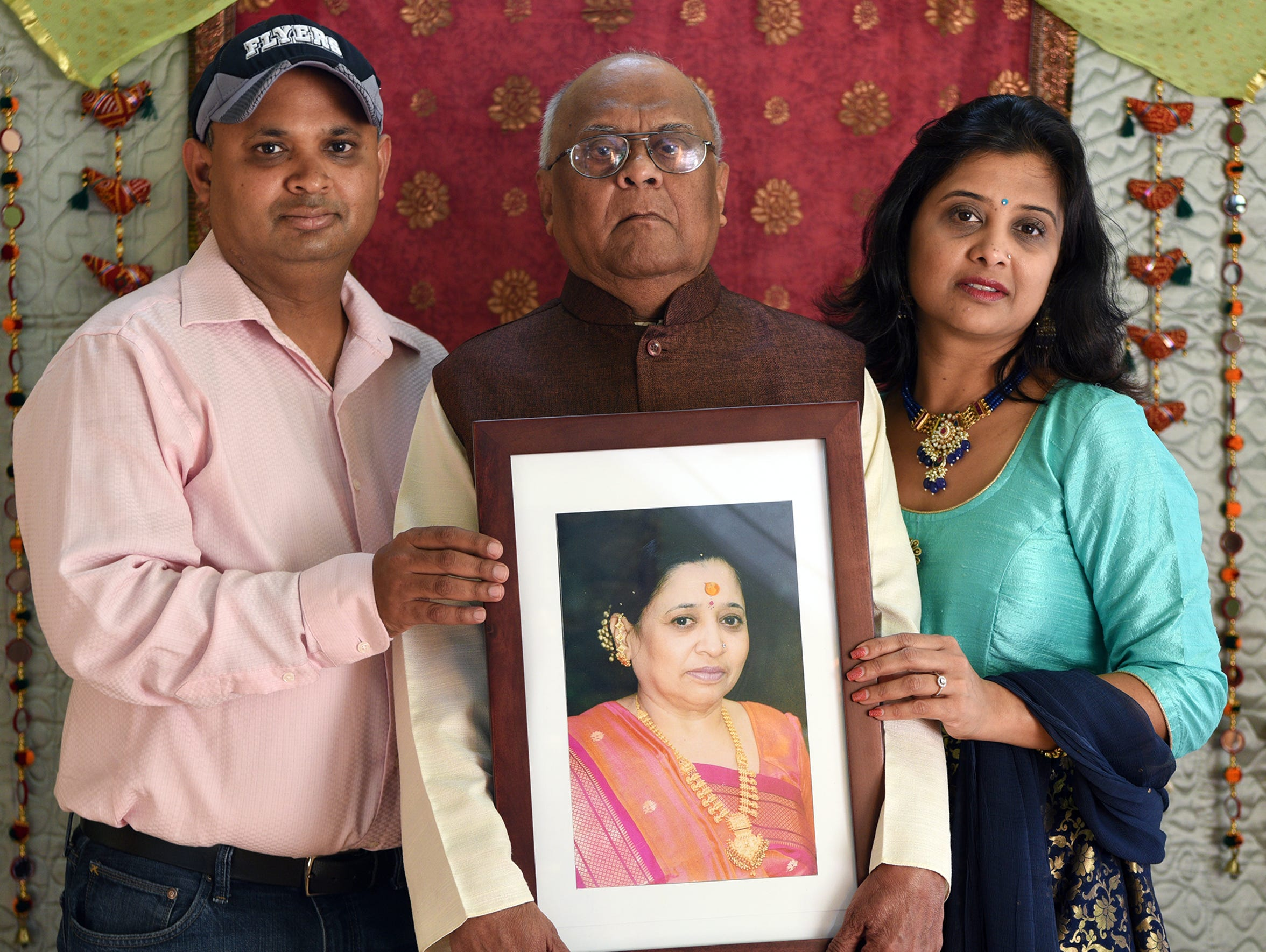 Rekhaben Shah's husband, Dharnedra, and their children,
