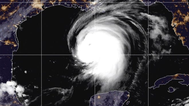 """This satellite image released by the National Oceanic and Atmospheric Administration (NOAA) shows Hurricane Laura churning in the Gulf of Mexico, Wednesday, Aug. 26, 2020.  Forecasters say Laura is rapidly intensifying and will become a """"catastrophic†Category 4 hurricane before landfall."""