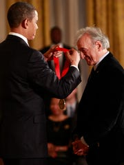 In this Feb. 25, 2010 file photo, President Barack Obama presents the 2009 National Humanities Medal to Elie Wiesel, in the East Room of the White House in Washington.