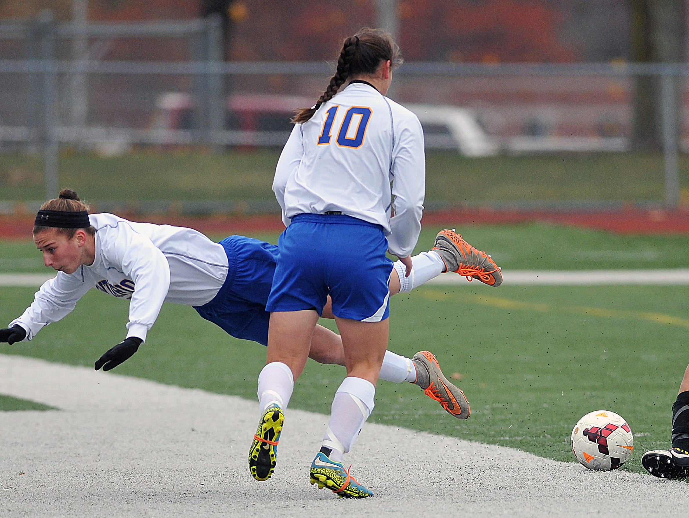 Ontario's Alexis Bise goes flying after a collision with Clear Fork's LaMeshia Curry girls soccer district championship at Ashland High School.