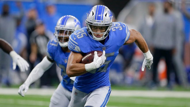 Miles Killebrew runs an interception back for a 35-yard touchdown late in the fourth quarter of the Lions' 35-23 win over the Cardinals at Ford Field on Sept. 10, 2017.