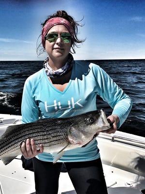 Fairfield resident Jaime Lynn Buffington holds a rock fish she caught on a recent fishing trip.