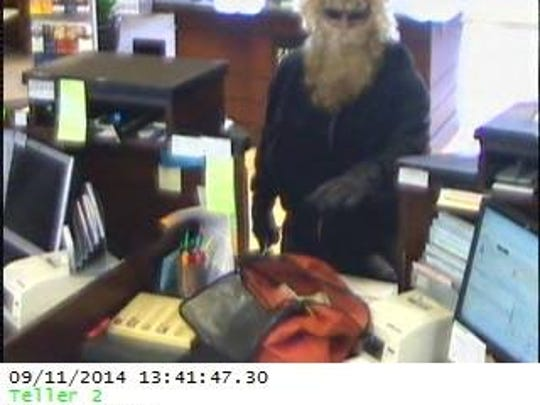 A disguised Benjamin Jay Schroff is seen in this Zions Bank video still Sept. 11, 2014 during a robbery. Schroff later died in a showdown with police in a field near the WashingtonCity / St. George city limits.