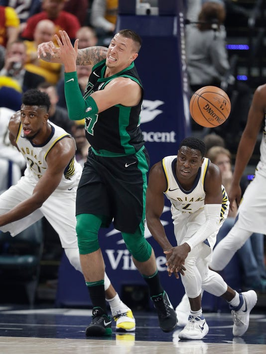 Boston Celtics' Daniel Theis (27) has the basketball stripped by Indiana Pacers' Darren Collison (2) during the first half of an NBA basketball game, Saturday, Nov. 25, 2017, in Indianapolis. (AP Photo/Darron Cummings)