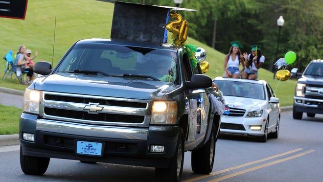 Crest seniors drive around Gardner-Webb University for a parade to celebrate graduation.