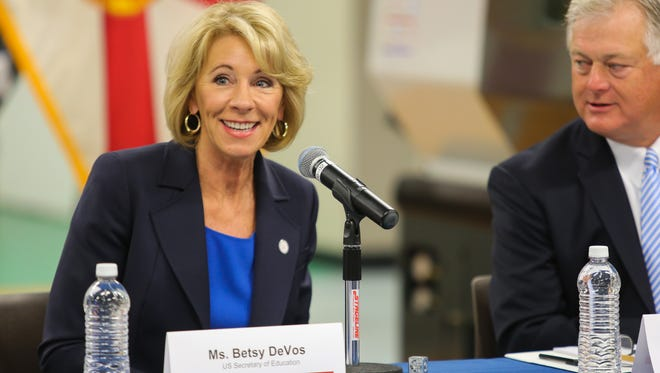 U.S. Education Secretary Betsy DeVos joined a round table discussion with manufacturing students at Valencia College in Kissimmee, Florida Friday March 24, 2017. Dr. Sandy Shugart, president of Valencia College, right, was also in attendance. DeVos visited the school to learn about vocational and dual enrollment programs.