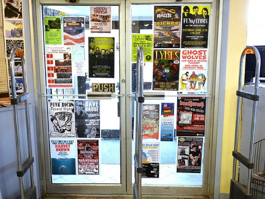 The Exclusive Company has dozens of concert posters papering the walls and doors at the store on Dousman Street in Green Bay.