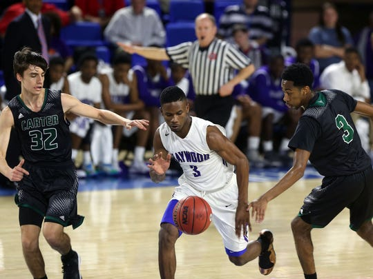 Haywood's Detarion Boyd chases a loose ball between Carter's Austin Hayes, left, and Jordan Bowden in the first half Thursday in the Class AA state quarterfinals at MTSU.