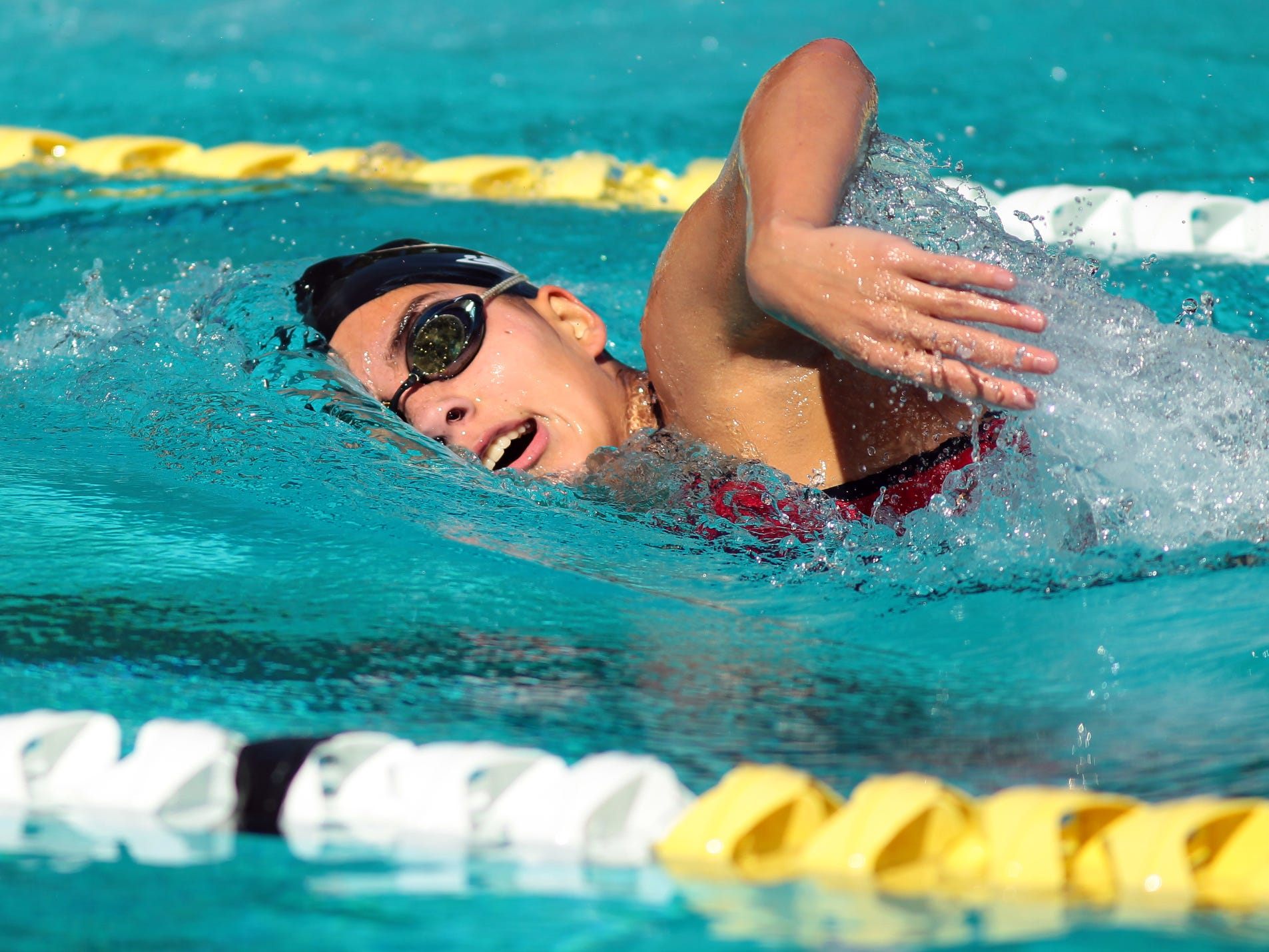 Danielle Davila swims the 200 free for Palm Springs during a high school swim meet against La Quinta on Thursday at the Palm Springs Swim Center.