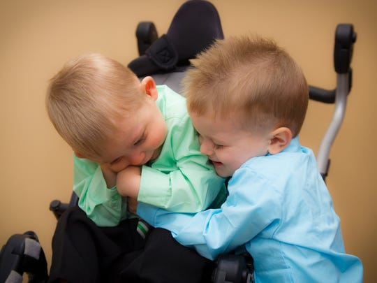 Isaiah Hoerter (right) hugs his brother closest in age, Jojo.
