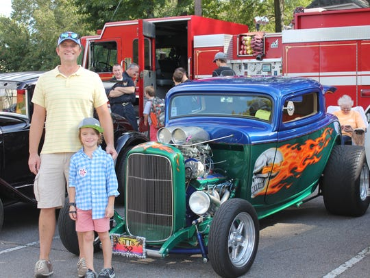Mr. Percoski and son Zachary enjoyed spending time together at Farmington Elementary's father-son car show on Oct. 2.