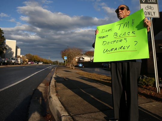 Edward Wynn protests outside of Tallahassee Memorial