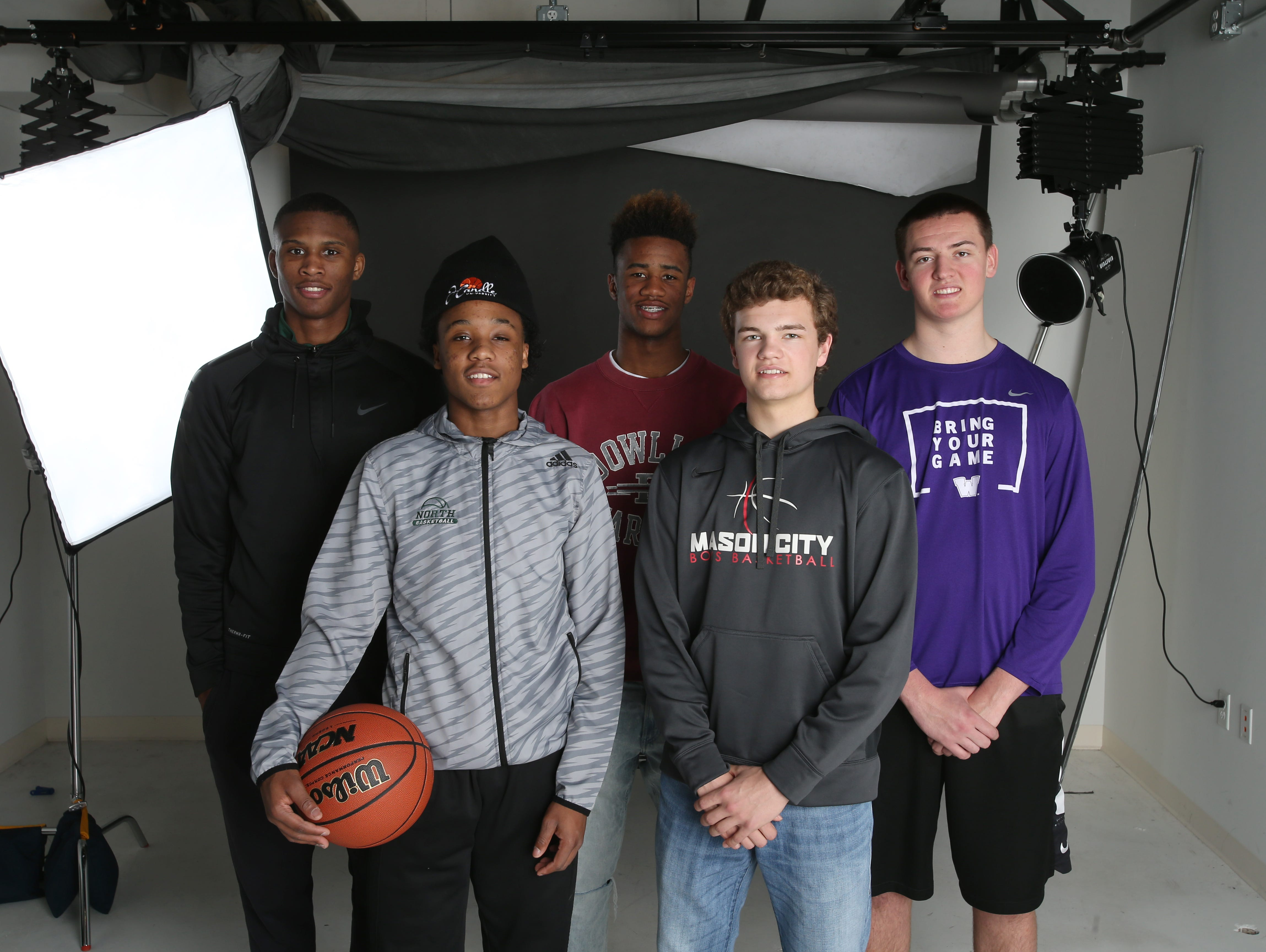 The Des Moines Register's All-CIML Elite boysÕ basketball selections, (front row) Tyreke Locure, North and Kyle Lang, Mason City, (back row) Doug Wilson, Hoover, Sam Ingoli, Dowling Catholic and Jacob Rau, Waukee photographed in the studio on Sunday, Feb. 26, 2017, in Des Moines.