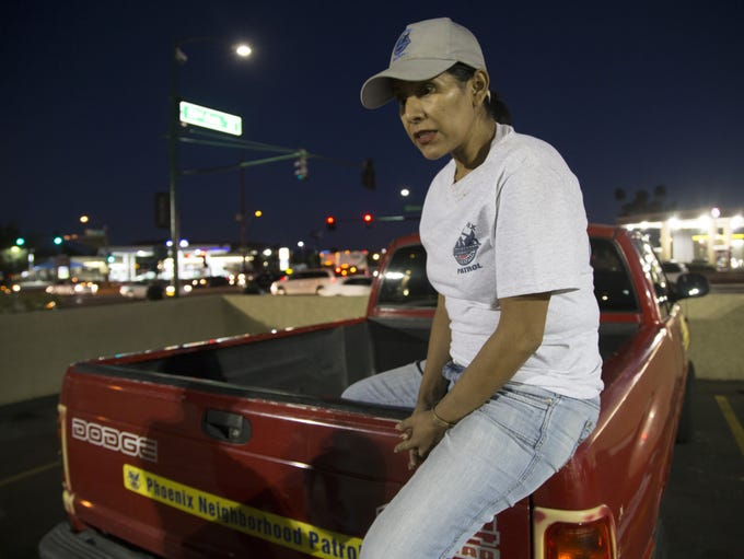 Rosa Pastrana sits on the edge of her pickup truck
