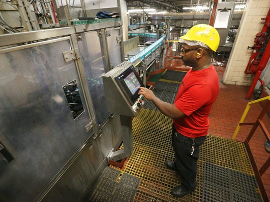 Willie Brunson, Rochester, works on one of the bottling lines at Genesee Brewery in Rochester Wednesday, Aug. 9, 2017.
