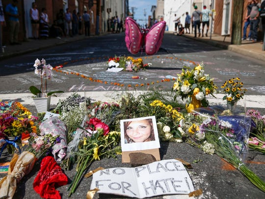 Flowers and notes are left in memory of Heather Heyer, who died after she was struck when a car plowed into a crowd protesting the 'Unite the Right' rally.
