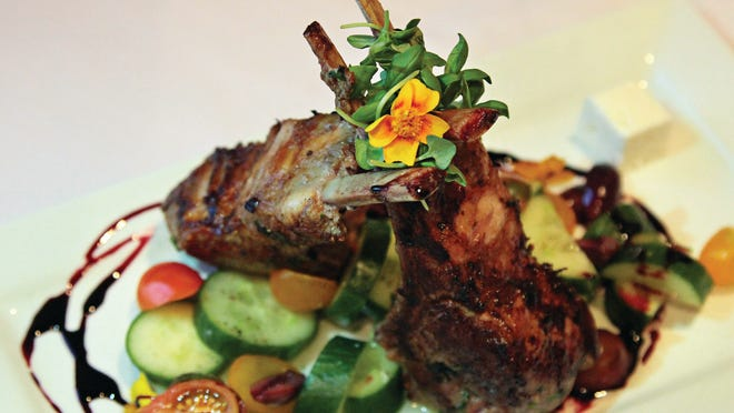 The Mediterranean Lamb Chops at dish—Creative Cuisine, made with tender double-bone chops from a ranch in nearby Brawley, are seasoned generously and sautéed in a cast iron skillet to get a nice sear and crust.