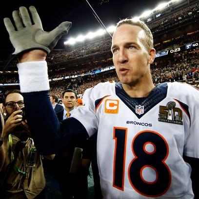Peyton Manning #18 of the Denver Broncos celebrates