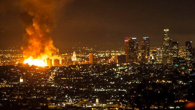 The fire in downtown Los Angeles could be seen for miles early Monday.