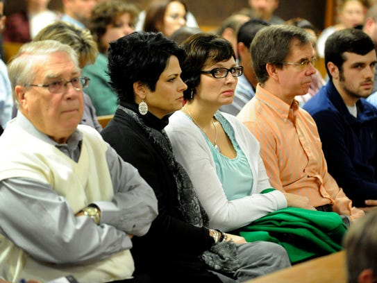 Kim Trussell, center with glasses, the widow of Cedar