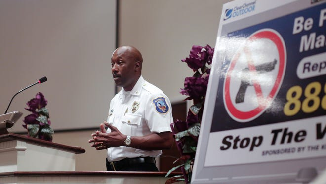 Inspector Bobby Cummings speaks at an August community meeting about shootings in Wilmington.