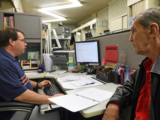 Jim Burghard, Jr., left, prepares taxes for customer Sam Hollar at Main Street Tax Service, Chambersburg, Thursday, September 19, 2017. Hollar, semi-retired, said he likes to get his taxes done as early as possible every year.