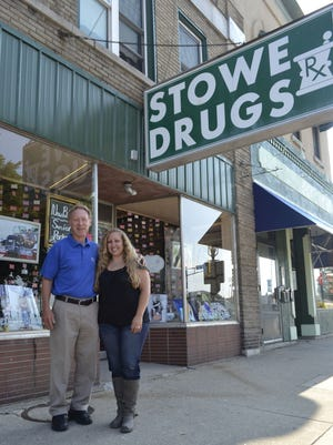 Dennis Larson and his daughter, Cortney Larson, stand outside Expressions Photography Studio at 375 Main Ave. in downtown De Pere. Cortney Larson operates the studio in the same historic building where Dennis Larson was the longtime owner and pharmacist for Stowe Drugs. Dennis Larson, who still owns the building, closed Stowe Drugs in 2014 after the 19th century building was home to a drugstore since 1900.