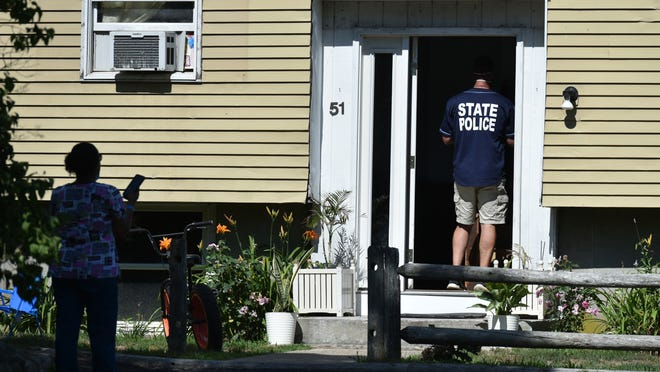 State police search a house at 51 Great Neck Road North in Mashpee on Tuesday as part of an investigation into a shooting Monday night in the area of nearby Collins Lane.