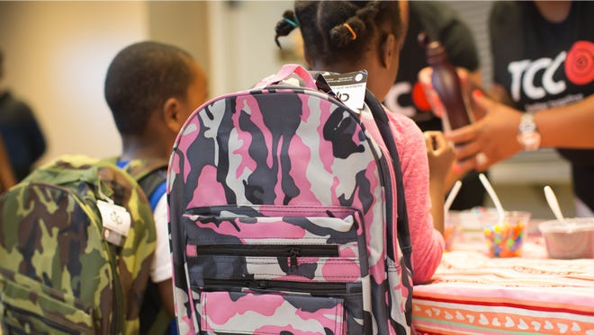 Students can pick up free backpacks at TCC Verizon Wireless stores in the Indianapolis area Sunday, July 22, 2018, as part of TCC's School Rocks Backpack Giveaway.