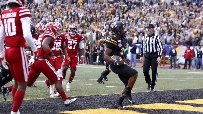 Appalachian State running back Darrynton Evans (3) runs in for a touchdown during the 2019 season. The New Smyrna Beach High School graduate and 2020 Tennessee Titans draft pick was one of many local athletes or coaches who weighed in on the racial tensions of the past few days.