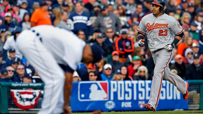 Oct 5, 2014; Detroit, MI, USA; Baltimore Orioles designated hitter Nelson Cruz (23) heads home after hitting a two-run home run off of Detroit Tigers starting pitcher David Price (14) during the sixth inning in game three of the 2014 ALDS baseball playoff game at Comerica Park. Mandatory Credit: Rick Osentoski-USA TODAY Sports
