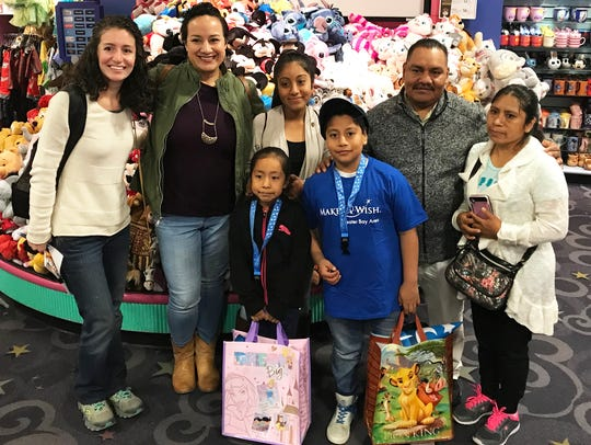 Make-A-Wish Foundation shopping spree with from left Jasmine Lopez, Gabriela Lopez and the Getulio Garcia Family of King City.