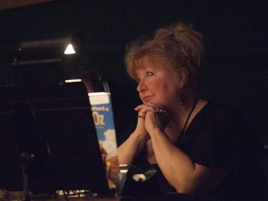 Cynthia Hartshorn watches the show from the orchestra pit on Friday, Feb. 26, 2016, at Tech High School. Hartshorn has been a musical director at Indianapolis Public Schools for 42 years.