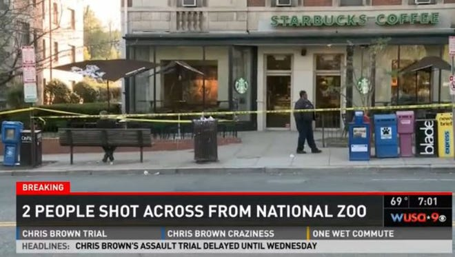 Police tape marks off the area across the street from the National Zoo in Washington, D.C., where two people were shot Monday, April 21, 2014.