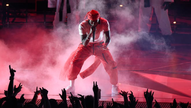Kendrick Lamar performs Aug. 27 at the MTV Video Music Awards at The Forum in Inglewood, California. He is among the performers scheduled to headline the 2018 Hangout Music Festival.