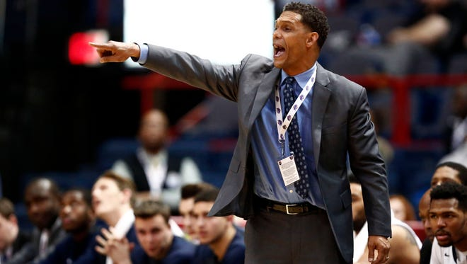 Monmouth Hawks head coach King Rice yells to his team against the Iona Gaels during the second half of the MAAC conference tournament finals on March 7 of last season at Times Union Center in Albany. Rice, a Binghamton High graduate, has Monmouth off to a 10-3 start this season.