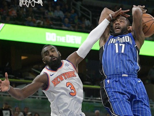 New York Knicks forward Tim Hardaway Jr. (3) blocks a shot by Orlando Magic forward Jonathon Simmons (17) during the second half of an NBA basketball game Thursday, Feb. 22, 2018, in Orlando, Fla. The Knicks won 120-113. (AP Photo/Phelan M. Ebenhack)