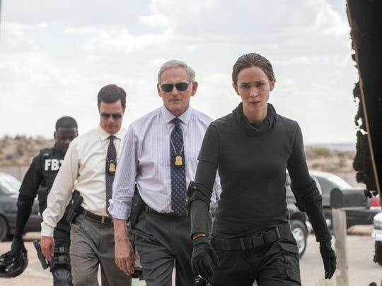 "Daniel Kaluuya, from rear left, Phil Coopers, Victor Garber and Emily Blunt appear in a scene in ""Sicario."""
