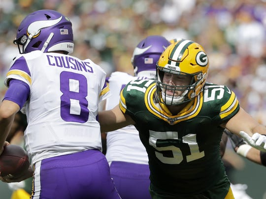 Green Bay Packers linebacker Kyler Fackrell (51) closes in on Minnesota Vikings quarterback Kirk Cousins (8) during their football game Sunday, August 15, 2019, at Lambeau Field in Green Bay, Wis.  Apc Pack Vs Vikings 0643 091519 Wag