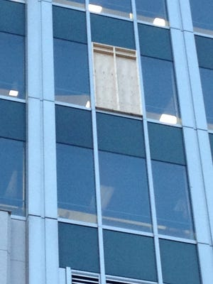 Windows shot out by apparent gunfire at Great American Tower were boarded and taped up as a temporary fix for the damage.