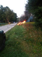 A car burst into flames after a crash on Pleasant Valley Road on Sunday, Aug. 27, 2017. No one was seriously injured in the incident. Photo submitted by reader Billie Jo Baughman