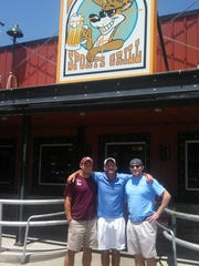 Leon High tennis coach Kevin Record with sons Josh and Kyle.