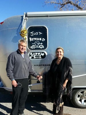 This photo shows a honeymoon trip photo of RV fanatics Philip Vasquez and Luci DiGiorgio posing in front of their Airstream RV after they married. They are the new owners of Oakdale Park in Glen Rose.